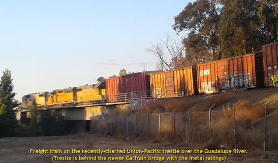 20171106_174237 freight train on charred trestle